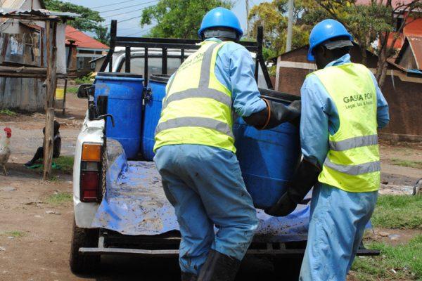 Gasia Poa pit emptiers at work in Kisumu, Kenya
