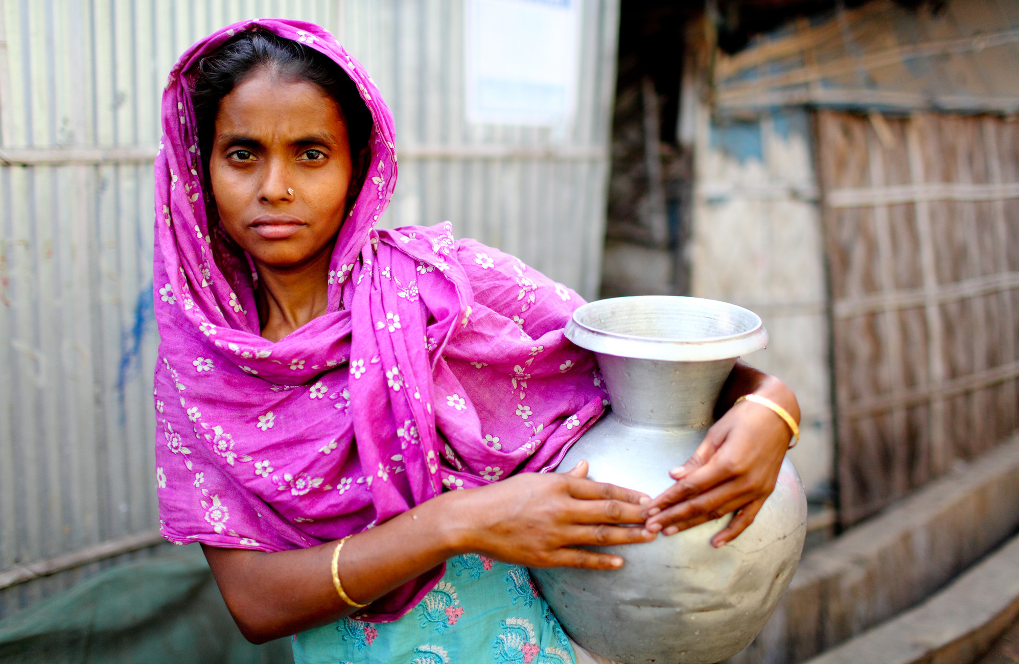Collecting water in Dhaka