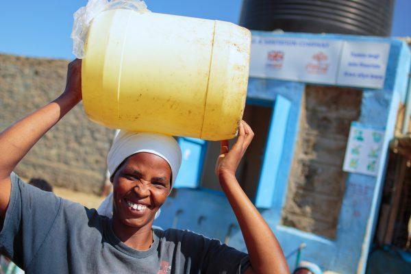 Water kiosk operator in Naivasha_ Kenya