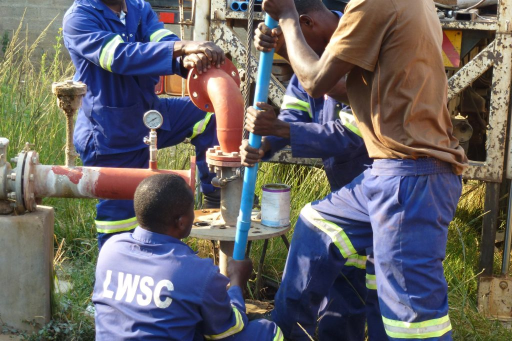 LWSC installing dip tubes & data loggers