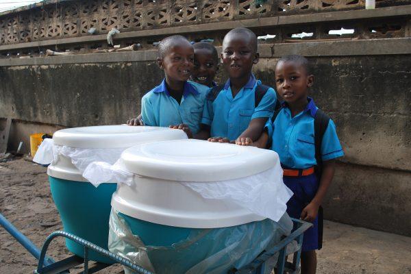 Children checking a Clean Team toilet