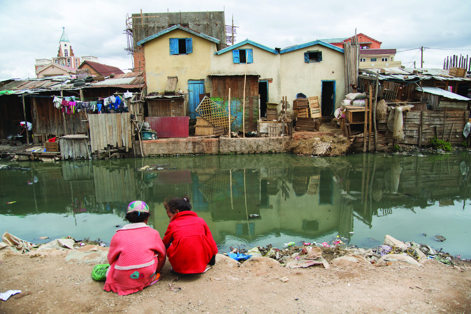 Children by polluted river