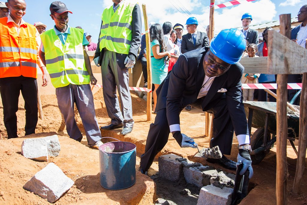 Laying the foundation stone for the school toilet