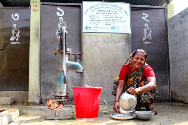 Doing the washing up in Kalshi Slum