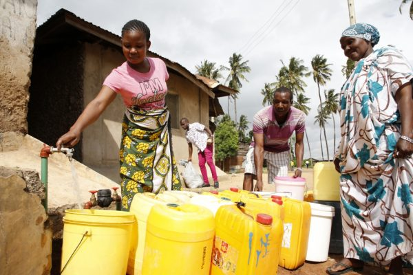 Local residents fetching water from their household yard tap